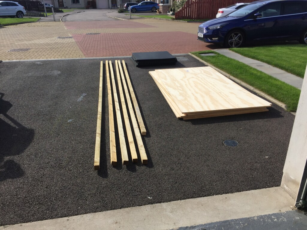 18mm plywood delivered - luckily it was dry! Rubber flooring in the background