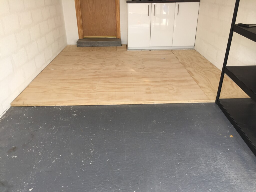 Garage plywood floor - second layer is staggered so all joins are covered