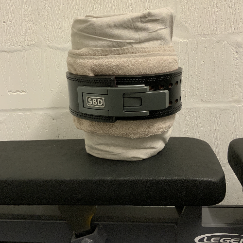 Breaking in my SBD 13mm lever belt by wrapping it around a towel & linen sheet